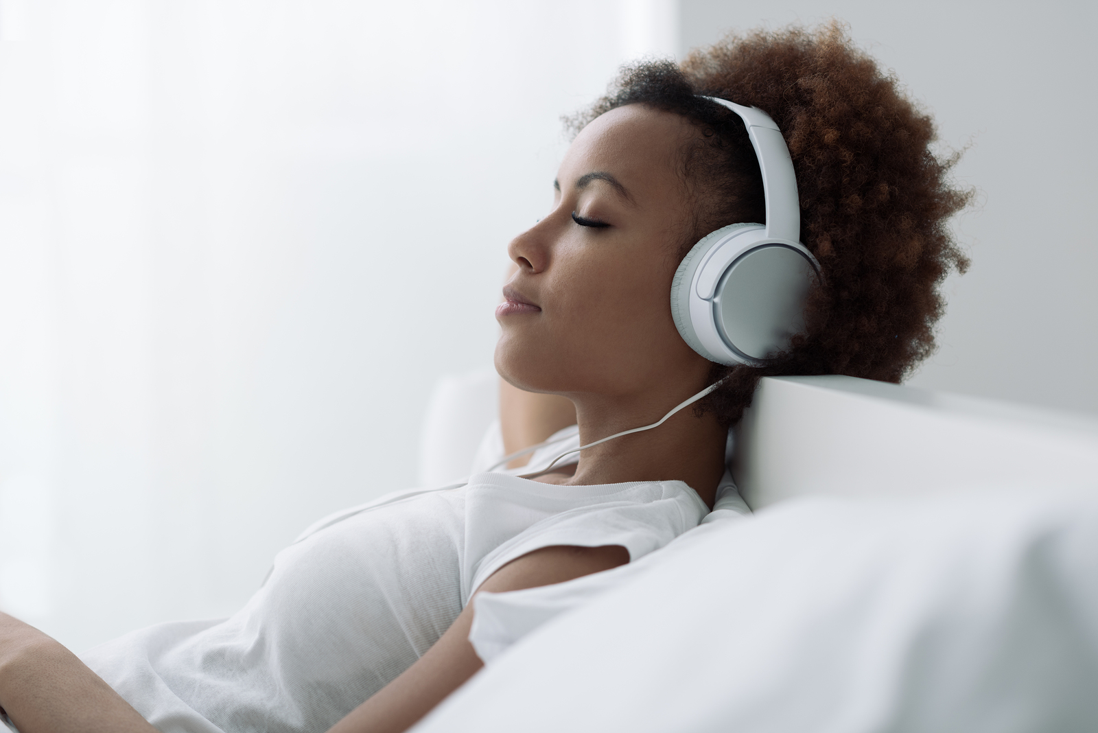 bigstock-Woman-Relaxing-And-Listening-T-169052453